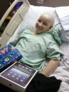 Kayson with his new iPad- Toby's Dream Foundation