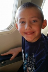 Dominic on an airplane to Disney World- Toby's Dream Foundation